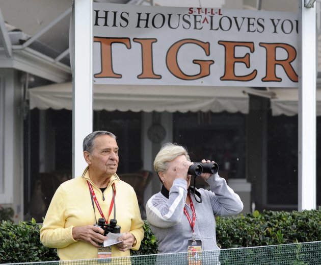 PGA National residents display a banner supporting Tiger Woods of the U.S. during the first round play in the Honda Classic PGA golf tournament in Palm Beach Gardens