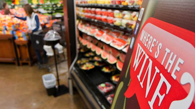 In this Friday, Nov. 30, 2012 file photo, a sign in a Kroger supermarket in Nashville, Tenn., urges shoppers to sign up for a group urging lawmakers to change state law that limits wine sales to liquor stores. (AP Photo/Erik Schelzig)