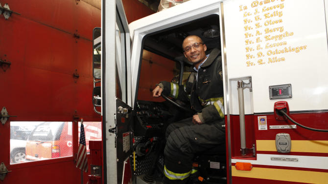 IMAGE DISTRIBUTED FOR EPIQ - Director of Brand Management Sports Nutrition for EPIQ Brent Coward sits in fire truck at EPIQ Thank You In Relief of Sandy on Tuesday, Feb. 5, 2013 in New York City. (Photo by Amy Sussman/Invision for EPIQ/AP Images)