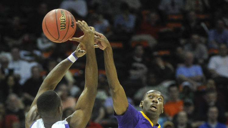 Mary Hardin-Baylor wing Thomas Orr  (3) blocks the shot of Amherst  guard Allen Williamson (10) during the first half of the NCAA college Division lll national championship basketball game on Sunday, April 7, 2013, in Atlanta. (AP Photo/John Amis)