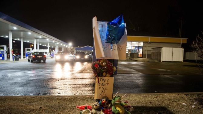 A memorial is set up at the scene where a policeman fatally shot a black man at a suburban St. Louis gas station in Berkeley, Missouri