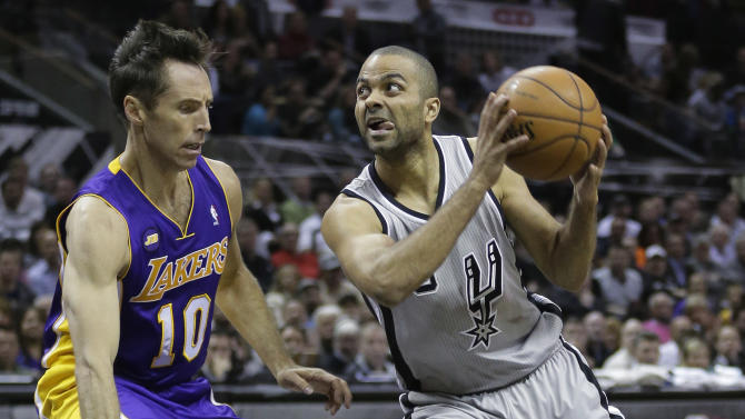 San Antonio Spurs' Tony Parker, right, of France, drives as Los Angeles Lakers' Steve Nash (10) defends during the first half of Game 2 of a first-round NBA basketball playoff series on Wednesday, April 24, 2013, in San Antonio, Texas. (AP Photo/Eric Gay)