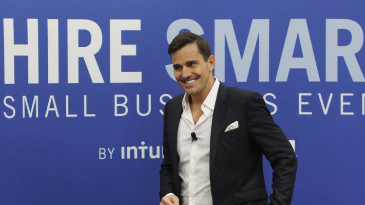 Bill Rancic speaks to attendees at the company's first ever Hire Smart Small Business Event on Saturday, April, 27, 2013 in Mountain View, Calif. The event offered small business owners free resources and expert advice for hiring employees. (Photo by George Nikitin/Invision for Intuit/AP Images)