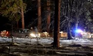 <p>Law enforcement officers check cars at the roadblock near Angeles Oaks during a standoff with fugitive ex-cop Christopher Dorner, near San Bernardino, California on February 12, 2013. Human remains found in a burnt-out mountain cabin in California have been confirmed as those of Dorner, the local coroner's office said Thursday.</p>