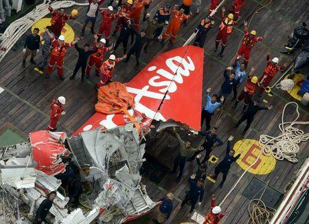 File photo shows the tail of AirAsia QZ8501 passenger plane seen on the deck of the Crest Onyx ship after it was lifted from the sea bed, south of Pangkalan Bun, Central Kalimantan