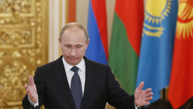 Russia's President Vladimir Putin welcomes the leaders of member countries of the Collective Security Treaty Organization (CSTO) in Moscow, Wednesday, Dec. 19, 2012. (AP Photo/Yuri Kochetkov, Pool)