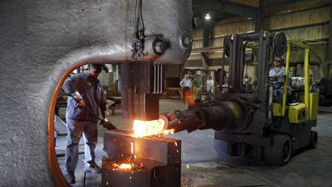 US industrial output rises but factories stay weak
