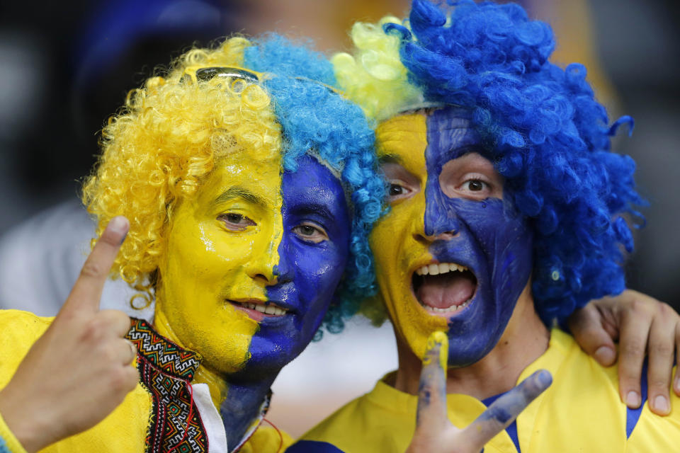 Ukraine supporters cheer prior to the Euro 2012 soccer championship Group D match between Ukraine and France in Donetsk, Ukraine, Friday, June 15, 2012. (AP Photo/Matthias Schrader)