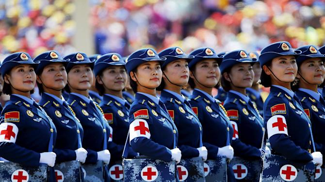 Military nurses look towards Chinese President and other leaders during the military parade marking the 70th anniversary of the end of World War Two, in Beijing