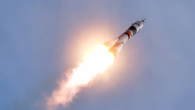 The Soyuz TMA-18M spacecraft carrying three astronauts, including the first Danish citizen ever to fly into space, launches towards the International Space Station