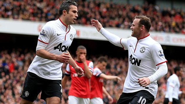 Manchester United's Robin van Persie (left) celebrates with team-mate Wayne Rooney after scoring his side's first goal of the gam from the penalty spot