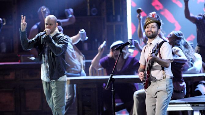 """Rene Perez Joglar, left, and Eduardo """"Visitante"""" Cabra, of the musical group Calle 13, perform on stage at the 15th annual Latin Grammy Awards at the MGM Grand Garden Arena on Thursday, Nov. 20, 2014, in Las Vegas. (Photo by Chris Pizzello/Invision/AP)"""