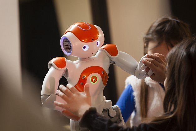 Researchers have found that disabled children might be able to learn how to enhance their engagement skills using the NAO robot (Nottingham Trent University/PA)
