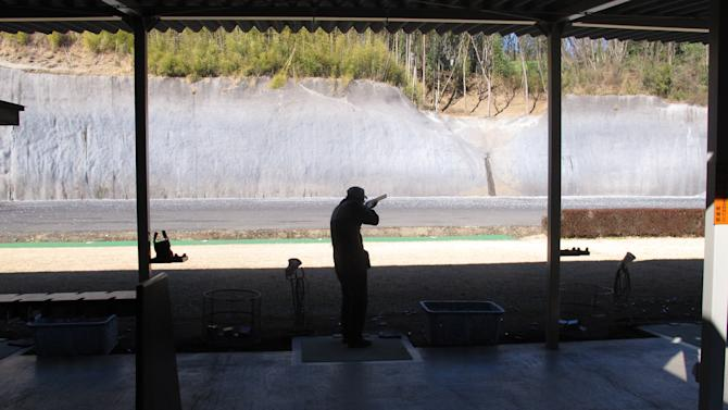 In this photo taken Friday, Jan. 18, 2013, a Japanese shotgun enthusiast takes a test to renew his license on a shooting range in Ooi at the foot of Mount Fuji, west of Tokyo. Guns are few and far between in Japan, which has strict gun restrictions and very little gun-related violence.  (AP Photo/Eric Talmadge)