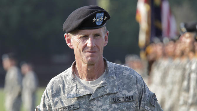 "FILE - This July 23, 2010 file photo shows Gen. Stanley McChrystal reviewing troops for the last time as he is honored at a retirement ceremony at Fort McNair in Washington. A memoir by retired Gen. Stanley McChrystal has been delayed pending security clearance from the U.S. Department of Defense. Portfolio announced Wednesday that McChrystal's ""My Share of the Task"" is still being reviewed by the Pentagon. McChrystal is the former commander of U.S. troops in Afghanistan.  (AP Photo/J. Scott Applewhite, file)"