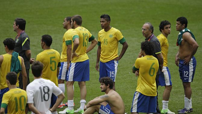 Brazil players reacts after losing the men's soccer final against Mexico at the 2012 Summer Olympics, Saturday, Aug. 11, 2012, in London. (AP Photo/Andrew Medichini)