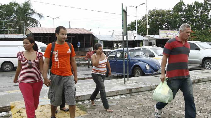 A group of Cubans arrive at the bus terminal after being released from Mexican immigration in Chetumal