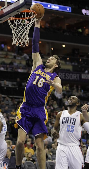 Los Angeles Lakers' Pau Gasol (16) gets free for the dunk as he scoots past Charlotte Bobcats' Al Jefferson (25) during the second half of an NBA basketball game in Charlotte, N.C., Saturday,