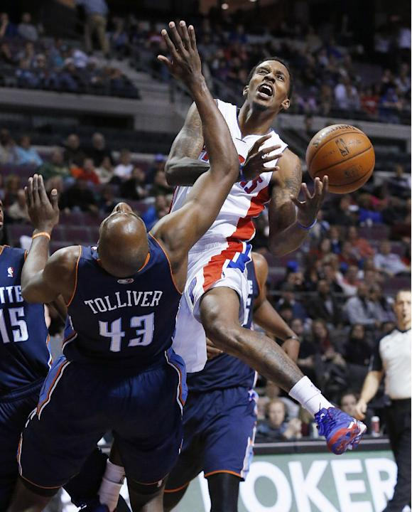 Detroit Pistons' Brandon Jennings drives on Charlotte Bobcats' Anthony Tolliver (43) during the second half of an NBA basketball game in Auburn Hills, Mich., Friday, Dec. 20, 2013