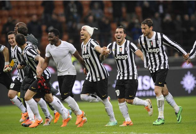 Juventus' players celebrate at the end of their Italian Serie A soccer match against AC Milan at the San Siro stadium in Milan