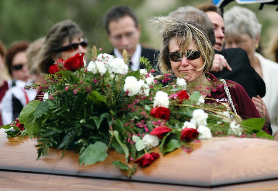 Sidney Middle School principal Kelly Johnson pays her respects during Sherry Arnold's funeral service in Sidney, Mont. on Friday, March 30, 2012. Arnold, a high school teacher, was kidnapped and murdered after disappearing in January. (AP Photo/Williston Herald, Elijah Nouvelage)