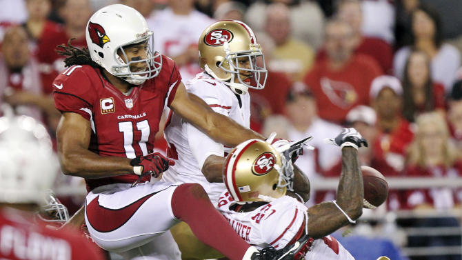 San Francisco 49ers defensive back Chris Culliver (29) and Carlos Rogers break up a pass intended for Arizona Cardinals wide receiver Larry Fitzgerald (11) during the first half of an NFL football game, Monday, Oct. 29, 2012, in Glendale, Ariz. (AP Photo/Paul Connors)