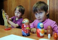 <p>Russian children play at an orphanage in Moscow on May 12, 2012. Russian lawmakers are set to debate a bill banning all adoptions by American citizens in retaliation at US human rights legislation, despite fierce opposition by ministers who say the move will rob scores of orphans of the chance of ever having a family.</p>