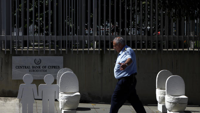 Cypriot puts mock toilets outside Central Bank