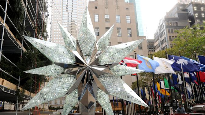 IMAGE DISTRIBUTED FOR SWAROVSKI - The 2012 Swarovski Star that will sit atop the Rockefeller Center Christmas Tree is unveiled, Tuesday, Nov. 20, 2012, in New York, and features 25,000 crystals and weighs 550 pounds.   Swarovski is the leading designer and producer of fashion jewelry and crystal decor objects. (Diane Bondareff/Invision for Swarovski/AP Images)