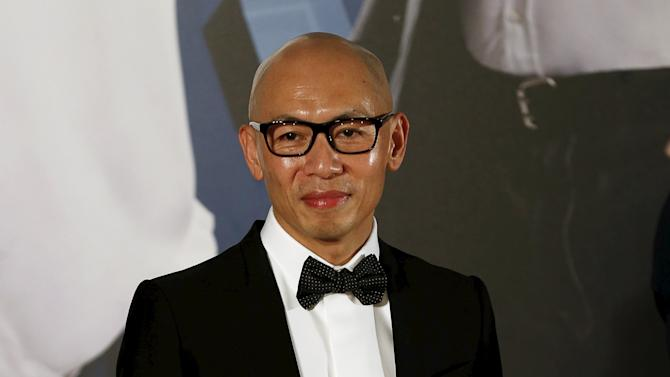Hong Kong director Dante Lam poses on the red carpet upon his arrival at Hong Kong Film Awards