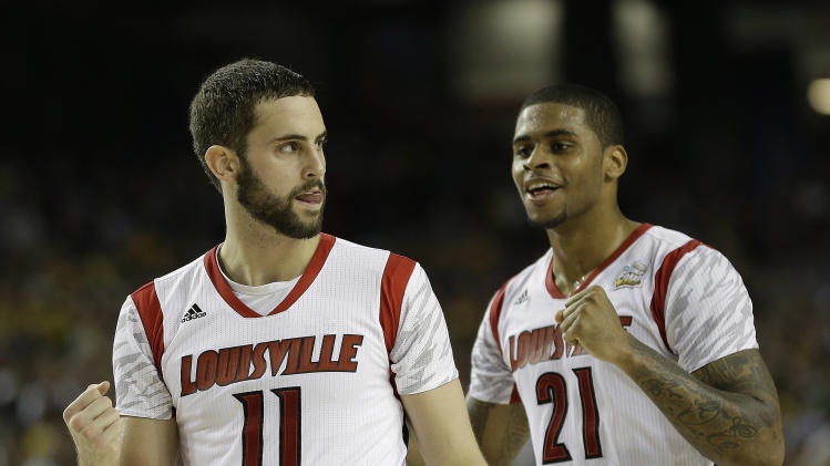 Louisville's Luke Hancock, left, and Louisville's Chane Behanan react to play against Wichita State during the second half of the NCAA Final Four tournament college basketball semifinal game Saturday, April 6, 2013, in Atlanta. (AP Photo/David J. Phillip)