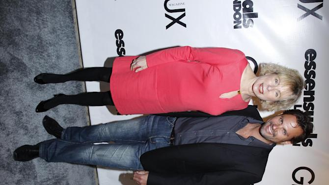 Actor Paulo Benedeti poses for a photo with Phyllis Klein of PKA PR at the Essensuals London Salon Launch Party and Fashion Show at the London Hotel on Tuesday, May 1. 2012 in Los Angeles, CA. (Joe Kohen/AP Images for Essensuals London Salon