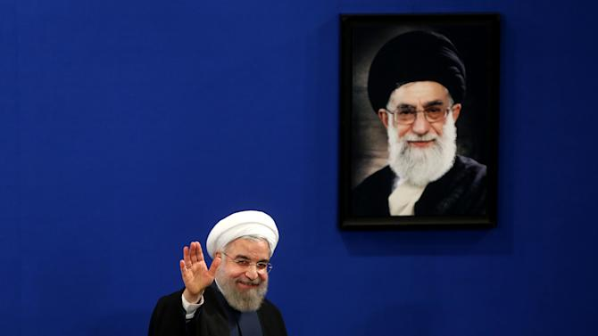 """FILE - In this Saturday, Aug. 29, 2015 file photo, Iran's President Hassan Rouhani waves to reporters at the conclusion of his press conference in Tehran, Iran.  Rouhani sent greetings to the Jewish people on the occasion of Rosh Hashana, the Jewish new year. Early Monday morning, Sept. 14, 2015, Rouhani's Twitter account posted the message, """"May our shared Abrahamic roots deepen respect and bring peace and mutual understanding. L'Shanah Tovah."""" (AP Photo/Ebrahim Noroozi)"""