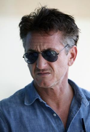 U.S. actor-activist Sean Penn talks to reporters outside his hotel during his visit to Tripoli, Libya Wednesday, Oct. 5, 2011. n Penn says he admires Libyans for their courage in overthrowing Moammar Gadhafi. (AP Photo/Abdel Magid al Fergany)
