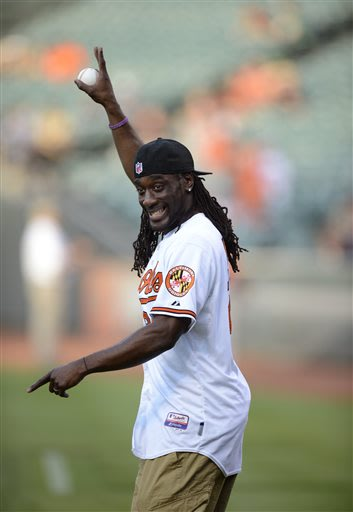 Baltimore Ravens NFL football player Lardarius Webb acknowledges the crowd before throwing out the ceremonial first pitch before a baseball game between the New York Yankees and the Baltimore Orioles,