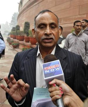 Uttam Khobragade, father of Devyani Khobragade, India's deputy consul general in New York, speaks with media after meeting India's Home Minister Shinde in New Delhi