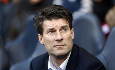 Swansea City's manager Michael Laudrup attends their English Premier League soccer match against Tottenham Hotspur in London