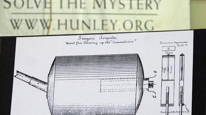 A diagram showing the design of a torpedo attached to the spar in front of the Confederate submarine H.L. Hunley is seen in North Charleston, S.C., on Monday Jan. 28, 2013. Scientists say they have found remnants of the torpedo casing on the spar indicating the Hunley was no more than 20 feet from the Union blockade ship Housatonic when the Hunley sank it off South Carolina in 1864, becoming the first sub in history to sink an enemy warship.   (AP Photo/Bruce Smith).