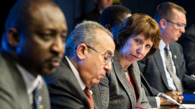 EU High Representative for Foreign Policy Catherine Ashton, 2nd right, looks at Mali's foreign affairs minister Tieman Coulibaly, left, as they address the media together with African Union Commissioner for Peace and Security Ramtane Lamamra, 2nd left, and United Nations under secretary general for political Affairs Jeffrey Feltman, right, after a ministerial meeting of the support and follow-up group on the situation in Mali, at the European Council building in Brussels, Tuesday, Feb. 5, 2013. Governments and international organizations meet on Tuesday to find ways to reinforce military gains against Islamist rebels in Northern Mali, by supporting democracy, economic development, and human rights in one of the world's poorest countries.(AP Photo/Geert Vanden Wijngaert)