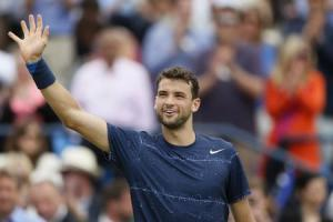Bulgaria's Dimitrov reacts after winning his men's singles semi-final tennis match against Switzerland's Wawrinka at the Queen's Club Championships in west London