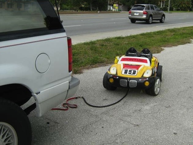 Grandparents allegedly tow 7-year-old behind SUV in toy car while ...
