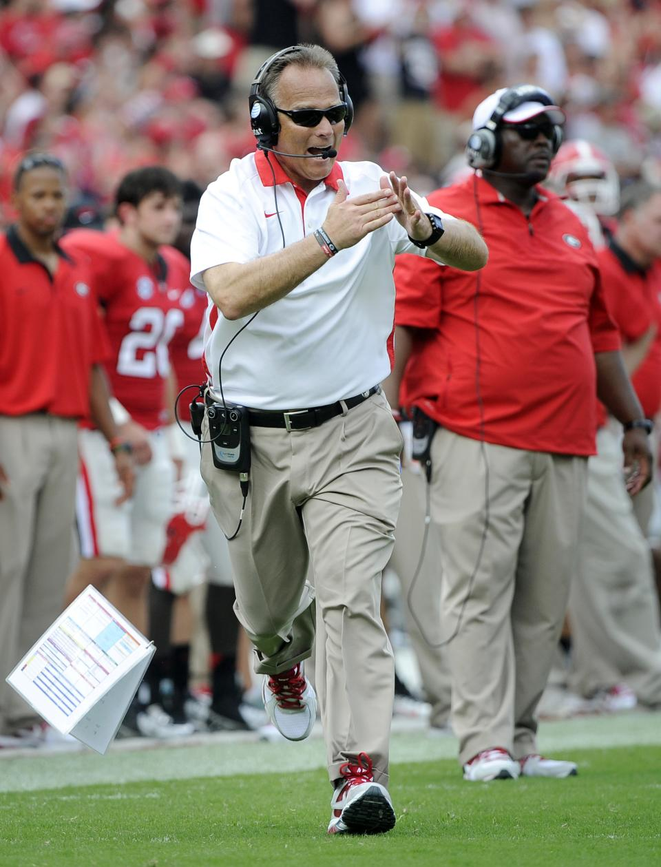 FILE - In this Sept. 1, 2012, file photo, Georgia head coach Mark Richt drops his playbook as he calls a timeout against Buffalo during an NCAA college football game in Athens, Ga. Georgia faces Alabama in the SEC Championship on Saturday. (AP Photo/John Amis, File)