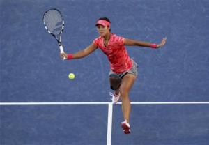 Li Na of China returns to Serena Williams of the U.S. at the U.S. Open tennis championships in New York