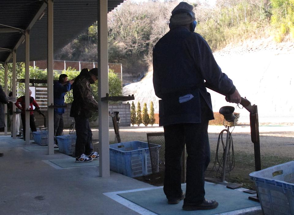 In this photo taken Friday, Jan. 18, 2013, Japanese shotgun enthusiasts take tests to renew their license on a shooting range in Ooi, at the foot of Mount Fuji, west of Tokyo. Guns are few and far between in Japan, which has strict gun restrictions and very little gun-related violence.  (AP Photo/Eric Talmadge)