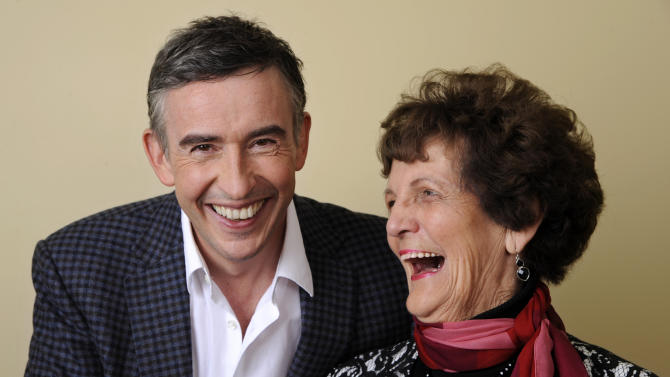 """In this Wednesday, Nov. 13, 2013 photo, Philomena Lee, right, shares a laugh with Steve Coogan, a cast member in the film """"Philomena,"""" as they pose together for a portrait at the Four Seasons Hotel in Beverly Hills, Calif. The British comic, Coogan, and Oscar-winning actress, Judi Dench, co-star in the film opening Friday, Nov. 22, 2013, which explores the benefits and costs of faith through the true story of Philomena Lee. (Photo by Chris Pizzello/Invision/AP)"""