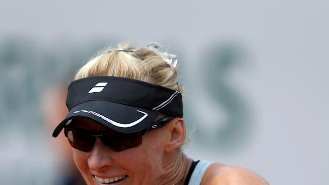 Mirjana Lucic-Baroni of Croatia plays a shot to Simona Halep of Romania during their women's singles match at the French Open tennis tournament at the Roland Garros stadium in Paris