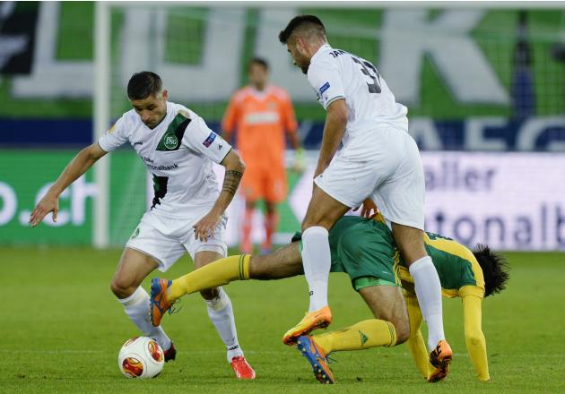 FC St. Gallen's Mario Mutsch, left, and Dejan Janjatovic, right, challenge  for the ball with Kuban Krasnodar's Ivelin Popv, center, during their UEFA Europa League Group A soccer  match between Switz