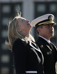 U.S. Secretary of State Hillary Rodham Clinton looks up at a monument for WWII victims in St. Petersburg, Russia, Thursday, June 28, 2012. (AP Photo/Dmitry Lovetsky)