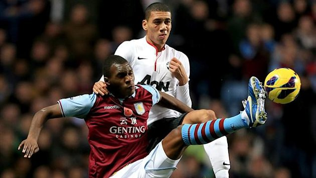 Aston Villa's Christian Benteke (left) and Manchester United's Chris Smalling battle for the ball