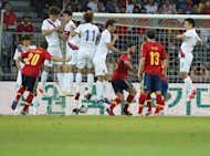 Spain's Santi Cazorla (L) scores a goal against South Korea during their international friendly football match in Bern. Spain won 4-1